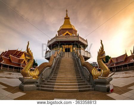 Art Of Thai Temple Roof With Blue Sky,wat Phothisompom Have Naga Beautiful At Udon Thani, Thailand,a