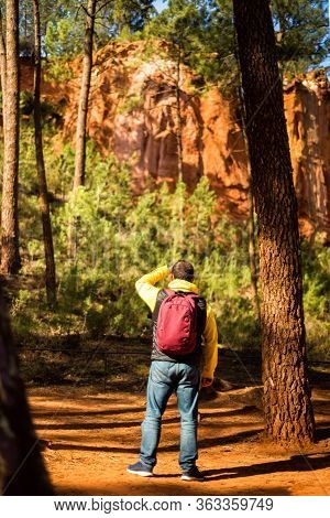 Vertical Picture Of Adult Man Tourist Standing On Ochre Trail In Roussillon In Alps Parc Nature Regi