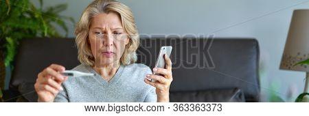 Sickness, Seasonal Virus Problem Concept. Senior Woman Being Sick Having Flu At Temperature On Therm