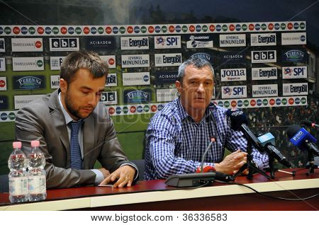 Soccer coach at press conference