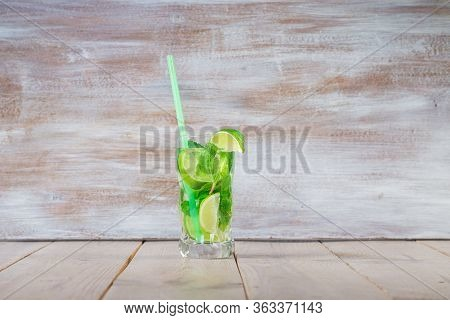 Lime Coctail Drink. Water In Two Glass And Lime With Mint On The Table