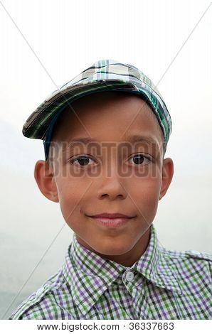 Boy With Brown Eyes In Cap