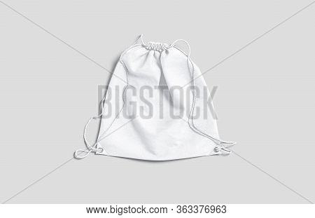 Blank White Drawstring Backpack Mockup Lying, Top View, 3d Rendering. Empty Cloth Hessian For Sports