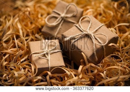 Gift Boxes In Natural Style In Natural Wood Shavings. Rustic Style.
