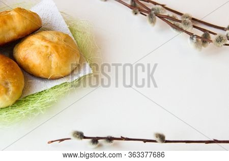 Bakery Background. Homemade Bakery. Pies On A White And Green Napkin And Willow Branches.traditional