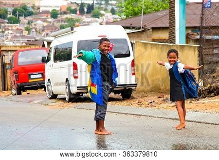 African School Kids Playing On A Main Road In Alexandra Township, A Formal And Informal Settlement