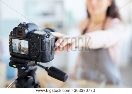 Modern Female Food Blogger Setting Her Camera Before Shooting Start, Horizontal Camera In Focus Shot