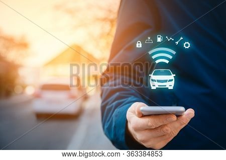 Intelligent Car App On Smart Phone Concept, Intelligent Vehicle And Smart Cars Concept. Person With