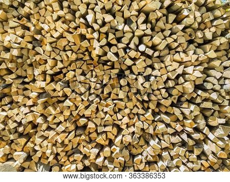 Close Up Of A Pile Of Chopped Firewood Prepared For Winter. Natural Wood Background.