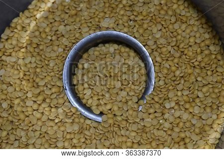 Toor Dal Filled Steel Bowl In Pile Of Toor Dal, Indian Pigeon Peas Dal