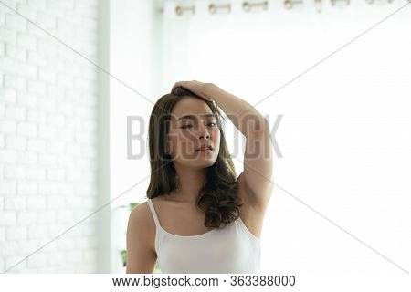 Asian Woman Cheerful And Healthy And Wearing White Pajamas Wake Up On Bed In Bedroom In The Morning.