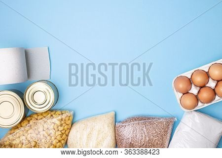 Delivery Food. Rice, Buckwheat, Pasta, Canned Food, Sugar, Toilet Paper On Blue Background. Voluntee