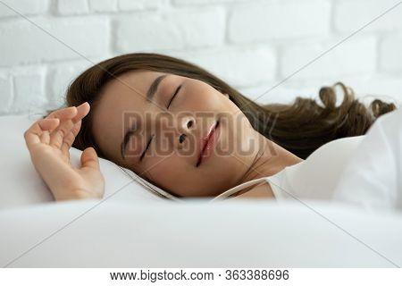 Beautiful Woman Sleeping On White Bed In The Bedroom,sweet Dreams, Keeps Eyes Closed, Enjoys Good Re