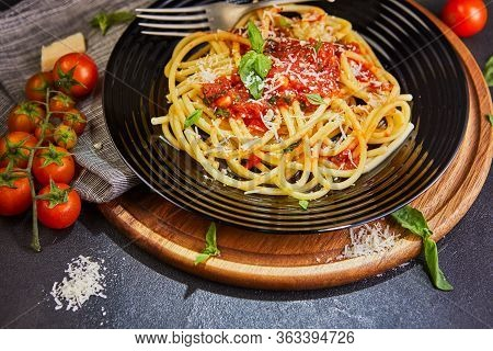 Delicious Mouth-watering Classic Italian Pasta Spaghetti With Tomato Sauce, Parmesan And Basil On A