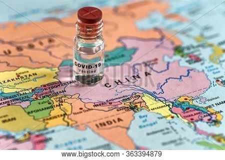 Coronavirus Covid-19 Vaccine And Map Of China And Asia At Background
