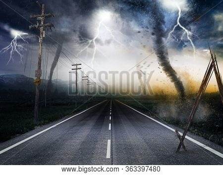 Destructive Powerful Tornados Along A Road Leading To The Horizon With Lightning In The Background,