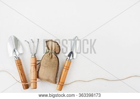 Gardening Tools On White Table. Spring In The Garden Concept, Top View, Flat Lay Composition.