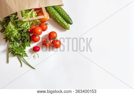 Paper Bag Full Of Vegetables On A White Background, Fresh Food Delivery, Vegetables And Greens On A