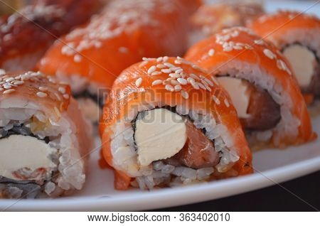 Sushi. Philadelphia Classic. Salmon, Philadelphia Cheese. Rolls With Eel And Soy Sauce.