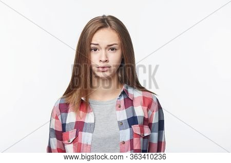 Discontent Confused Teen Girl Looking At Camera