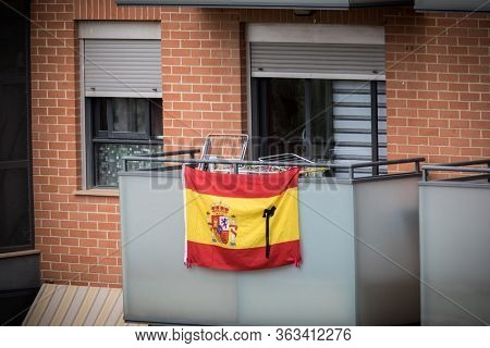 A flag of Spain with black crespon to remember the victims of covid-19 during coronavirus disease in Valencia, Spain, on April 10, 2020.