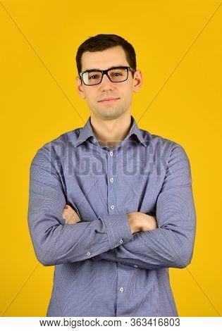 Smart Boy. Bad Eyesight. Cool Guy Wear Eyeglasses Yellow Background. Man Look Through Fancy Eyeglass