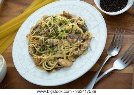 Mushrooms Over Spaghetti . Raw Spaghetti Pasta Inside A Bowl . Black Pepper, Mayonnaise Inside A Bow
