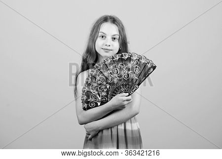 Cooling And Ventilation. Waving To Create Current Air. Little Girl Waving Elegant Fan. Summer Heat.