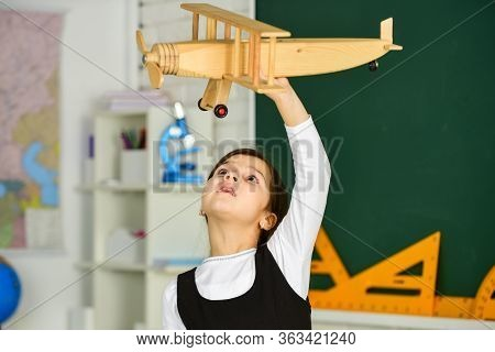 Keep Dreaming. Schoolgirl Play Wooden Toy Airplane. Fly On Plane. Study Geography. Around World. Dre