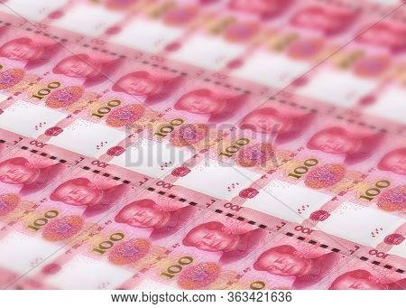 Stacks Background Of Millions Banknotes Of 100 Chinese Yuan With Mao Tse-tung Leader. Concept Of Pri