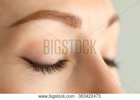 Closed Eyes Of Beautiful Red Haired Woman In Morning Sunshine Close-up