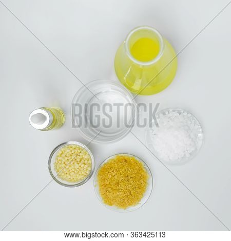 Cosmetic Chemicals Ingredient On White Laboratory Table. Carnauba Wax Flakes Sp-200, Candelilla Wax