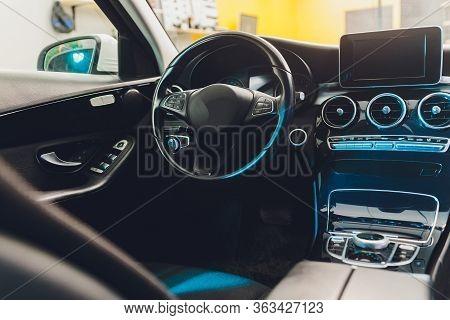 Dark Luxury Car Interior - Steering Wheel, Shift Lever And Dashboard. Car Interior Luxury. Beige Com