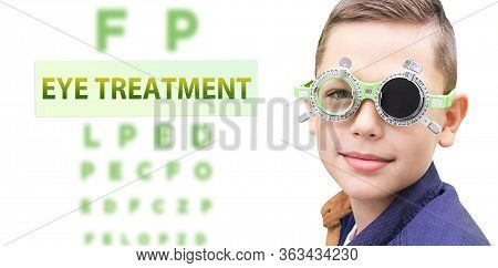 Child Eye Treatment. Boy While Vision Treatment, Wearing Special Glasses.
