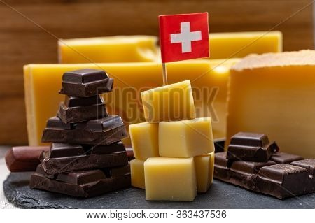 Tasty Swiss Food, Block Of Medium-hard Yellow Cheese Emmental Or Emmentaler With Round Holes, Mature