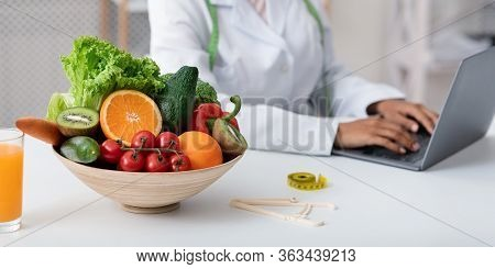 Cropped Of Black Female Nutritionist Working With Laptop At Office, Panorama