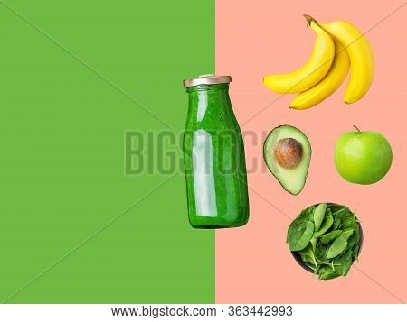 Glass Bottle With Green Smoothie Ingredients Fresh Raw Spinach Apples Bananas Avocado On Duotone Pin