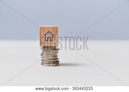 Home Budget. Savings For Buying House. Real Estate Market. Property Investment. Stack Of Coins With