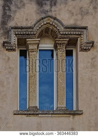 Elegant Window Portal With A Triple Window On The Old House.