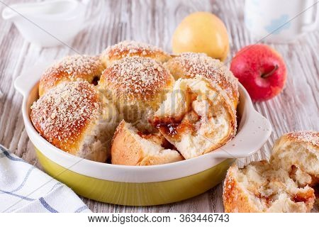 Homemade Bun With Crumb And Jam On A White Wooden Background. Bun With Crumb. Bun Sprinkled With Cru