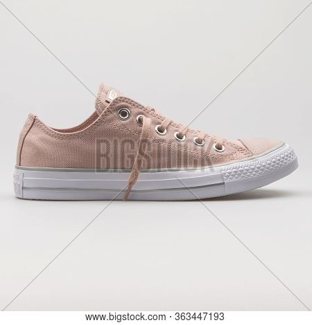 Vienna, Austria - February 19, 2018: Converse Chuck Taylor All Star Ox Beige And White Sneaker On Wh