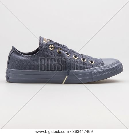 Vienna, Austria - February 19, 2018: Converse Chuck Taylor All Star Ox Light Carbon And Gold Sneaker