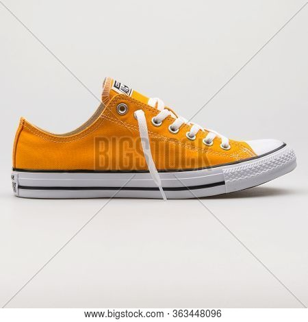 Vienna, Austria - February 19, 2018: Converse Chuck Taylor All Star Ox Orange And White Sneaker On W