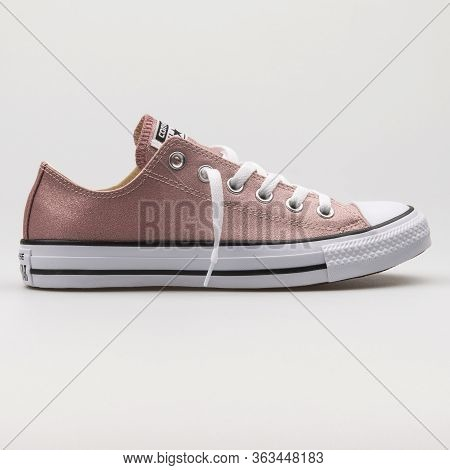 Vienna, Austria - February 19, 2018: Converse Chuck Taylor All Star Ox Rose And White Sneaker On Whi