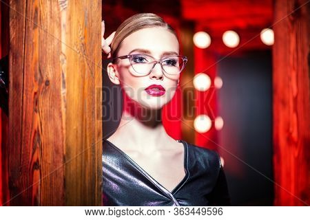 Portrait of a confident lady wearing glasses. Beauty, make-up, style.