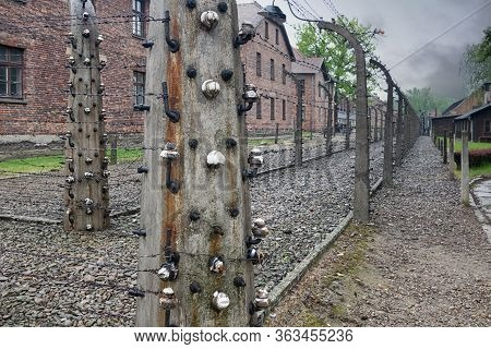 Oswiecim, Auschwitz, Poland - May 15, 2019: Buildings Of Concentration Camp Auschwitz Surrounded Bij