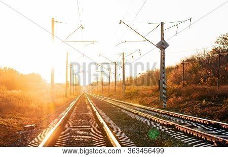 Electrified Railway On Sunset Background