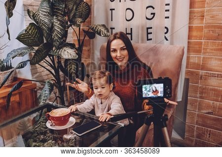 Online Jobs For Stay-at-home Moms. Work From Home Women With Kids. Blogger Girl And Her Little Daugh