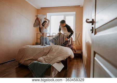 Isolating Together. Mother And Daughter Pillow Fight In Bed. Couple Stay Home. Family Lockdown, How
