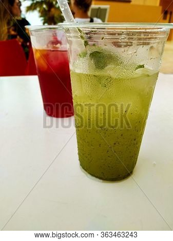 A Cool Mint Mojito Drink With Ice And Bubbles In A Clear Plastic Cup For The Summer Holidays Days
